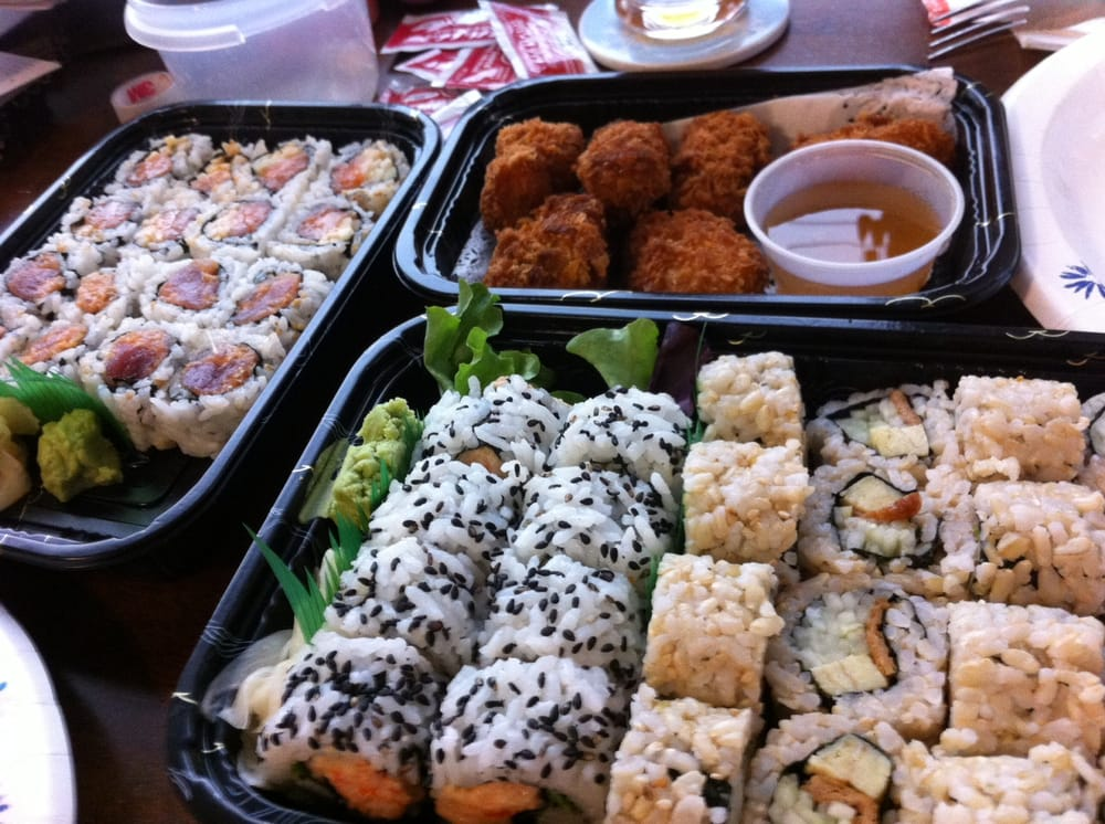 Left spicy tuna and spicy salmon maki top fried oyster for Asian cuisine appetizers