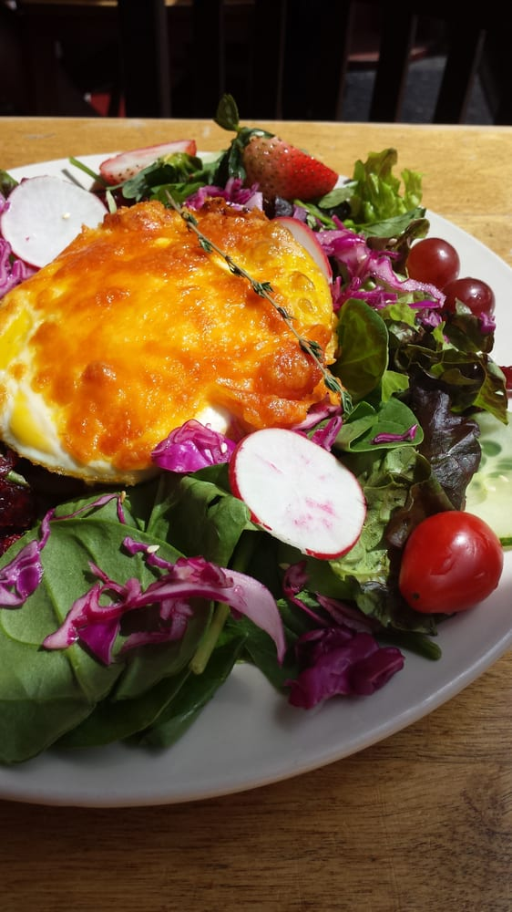 bacon wrapped baked eggs with polenta & mixed field greens ...