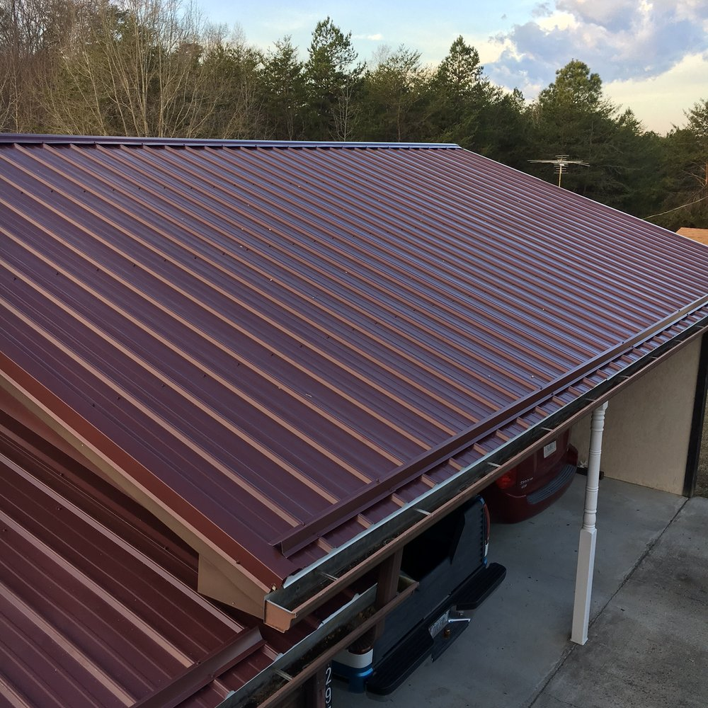 Painted Metal Roof With Snow Bars Installed On The Bottom