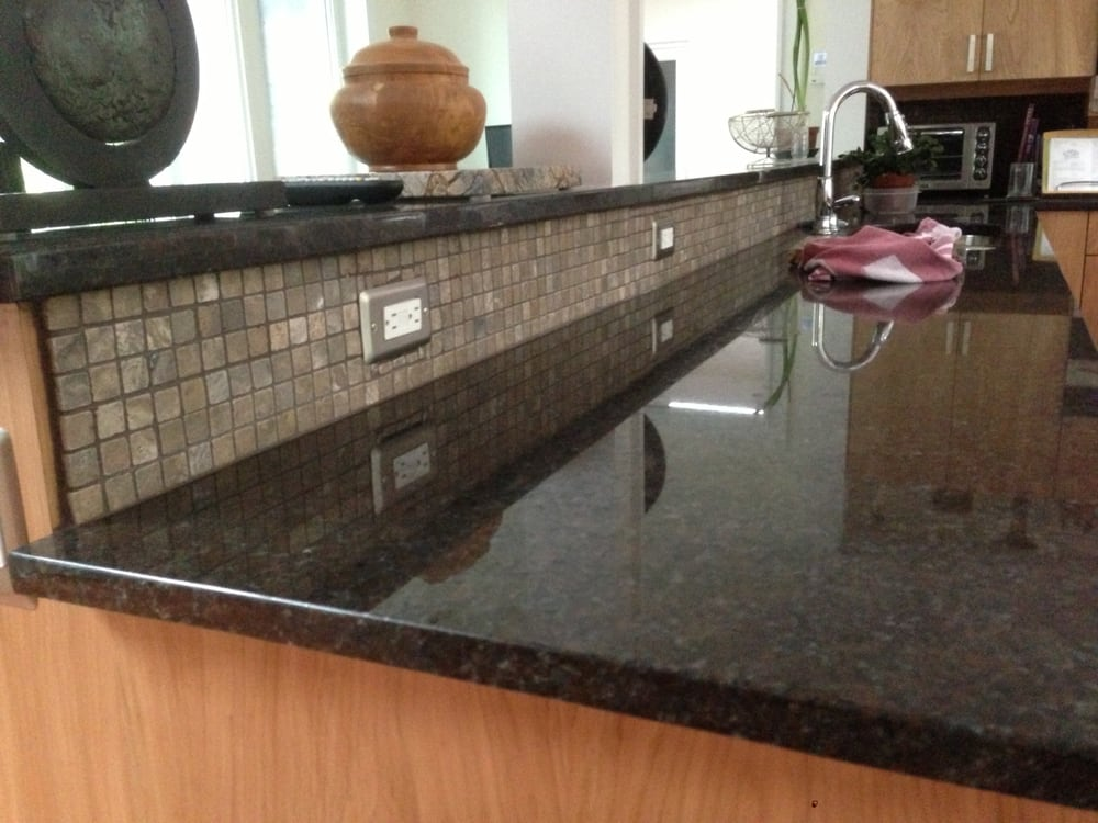 Coffee brown countertops and raised bar yelp for Granite countertop support requirements