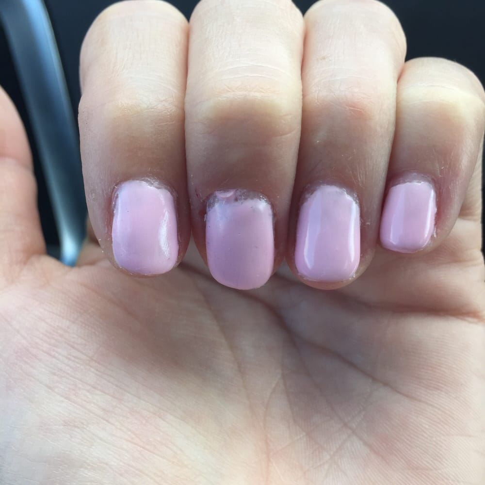 Freshly painted gel nails. Paint was not evenly applied near ...