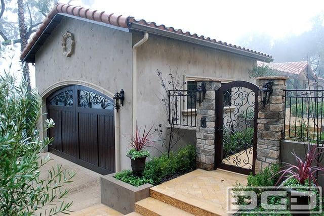 Mediterranean style garage doors matching entry gates for Mediterranean garage doors