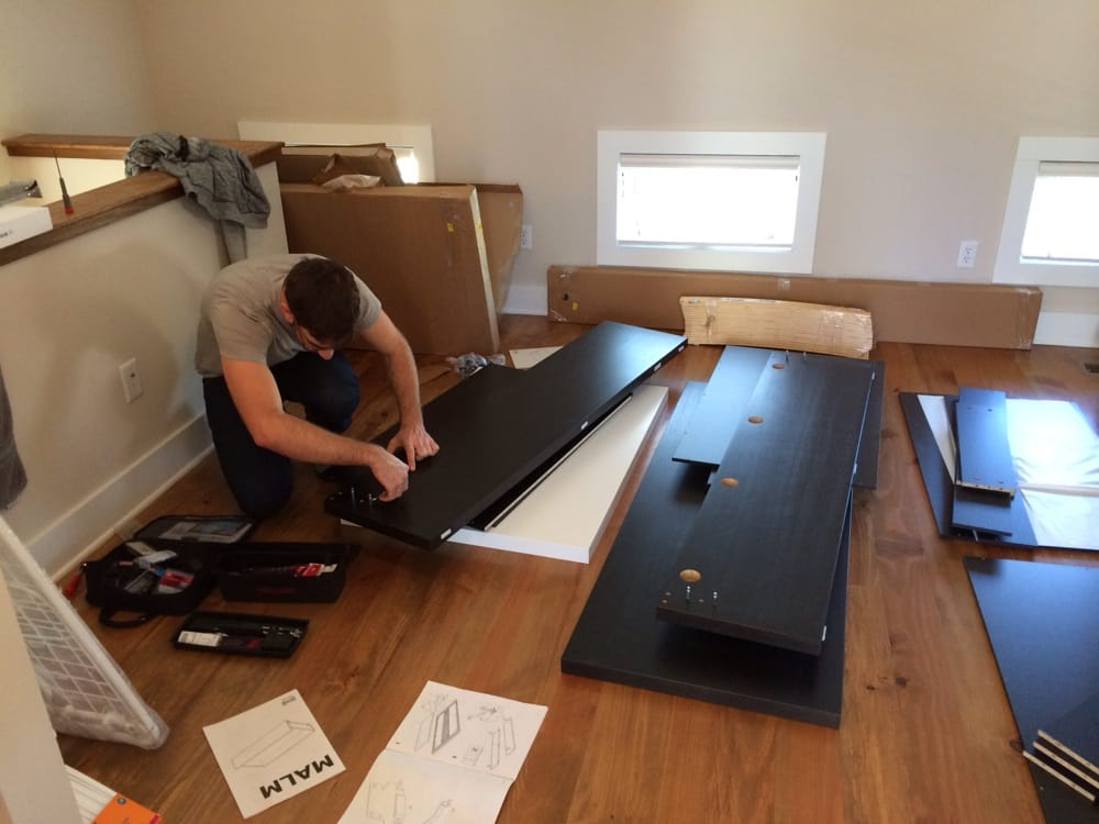 brian working hard to put my ikea malm bed together yelp