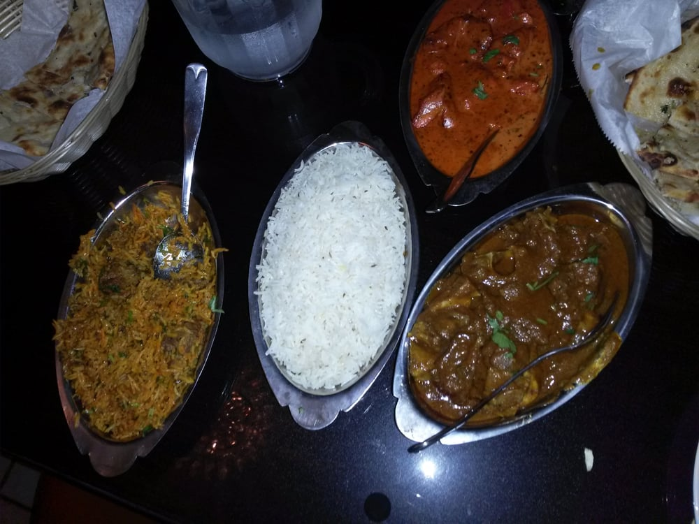 White basmati rice in the middle to its right is goat for 5 star indian cuisine