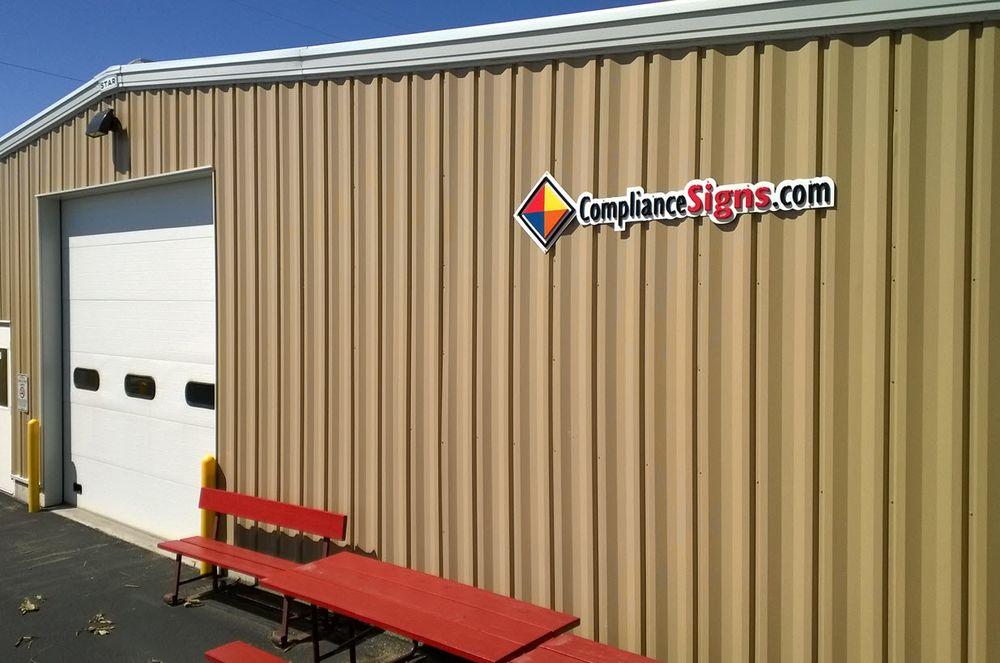 ComplianceSigns: 56 S Main St, Chadwick, IL
