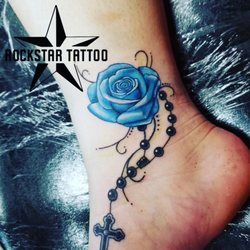 1029dfc9a Photo of RockStar Tattoo - Las Vegas, NV, United States. Rose and rosary