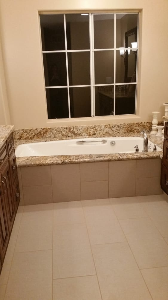 Roman Tub deck from Cabinet Depot. Also, the tile installer was ...