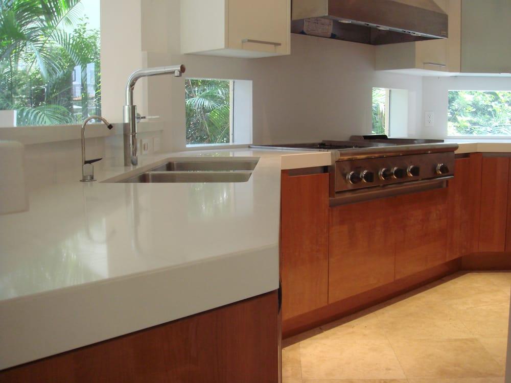 "absolute white quartz kitchen countertop with 3"" mitered"