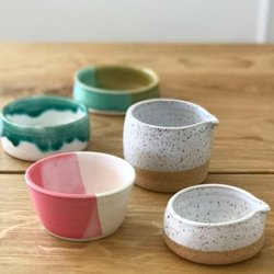 clay ceramic cups and bowls