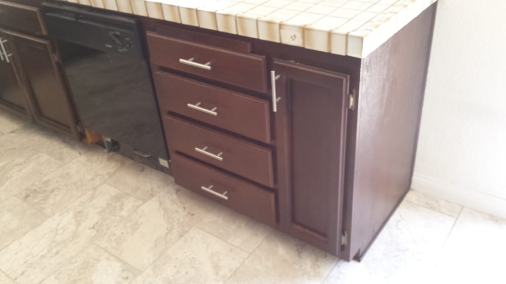 Old oak cabinets after stain and clear coat - Yelp