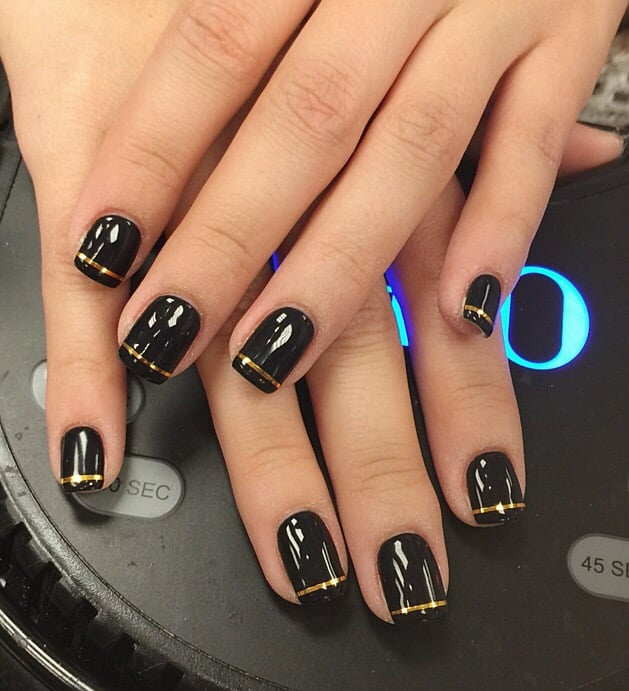 Black gel nails with gold foil nail tape design by Sarah - Yelp