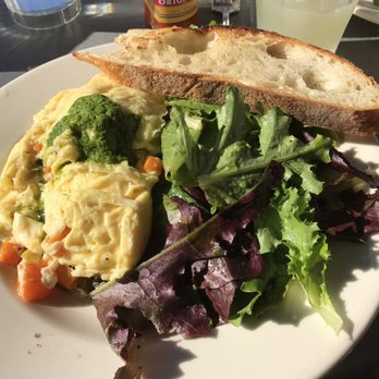 Soft scrambled eggs cooked to perfection with vegetables and pesto ...