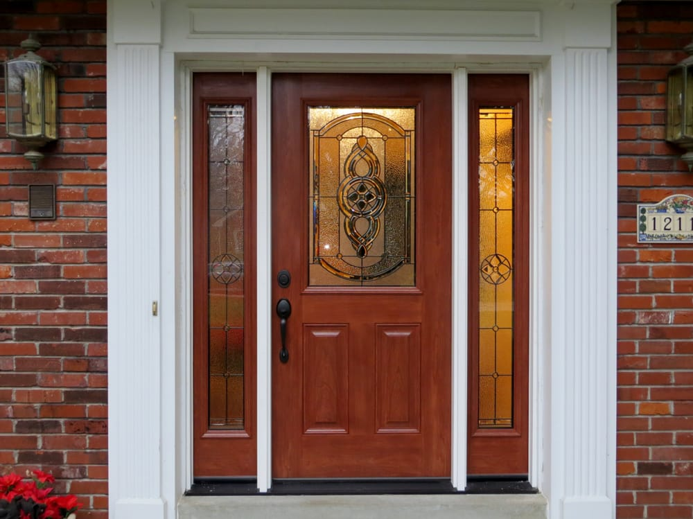 A Fiberglass Entry Door With Half Glass And Full Glass Sidelights In
