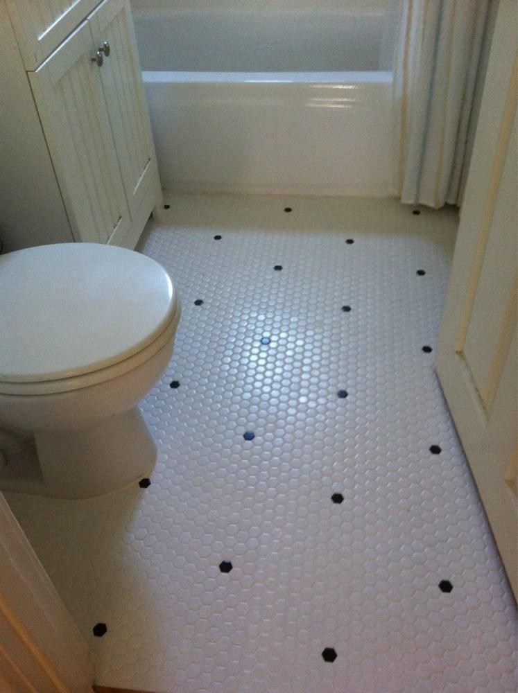 Hexagonal tile floor with custom black tile placement - Yelp