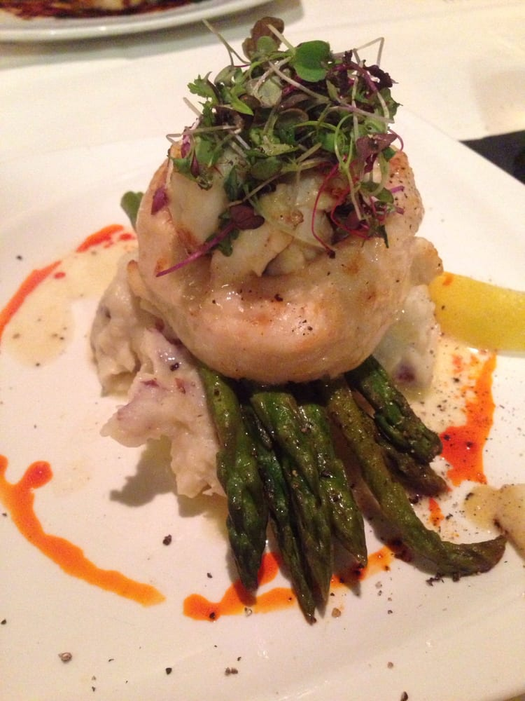 Crab stuffed flounder with asparagus over a bed of garlic for Crab stuffed fish