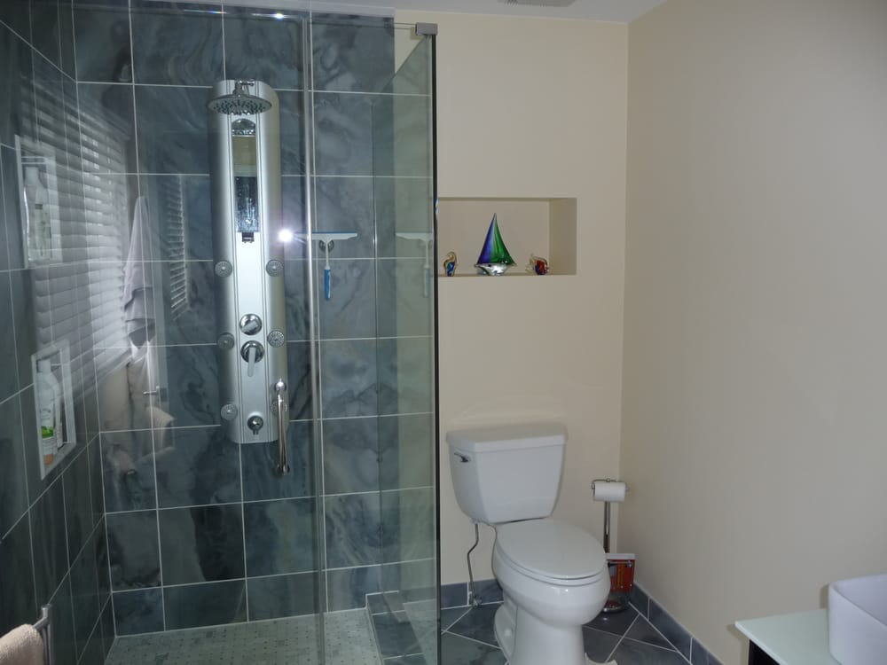 blue marble tiles with glass shower enclosure; also installed new ...