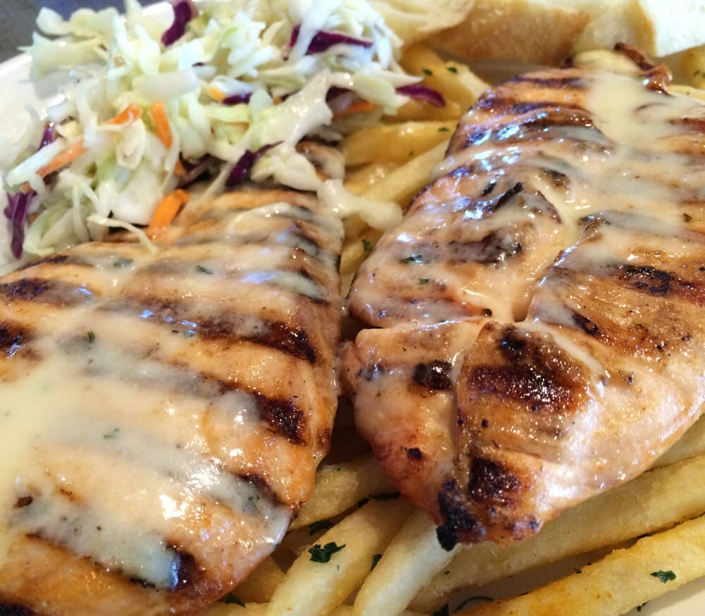 Salmon with garlic butter fries and coleslaw for only for California fish grill