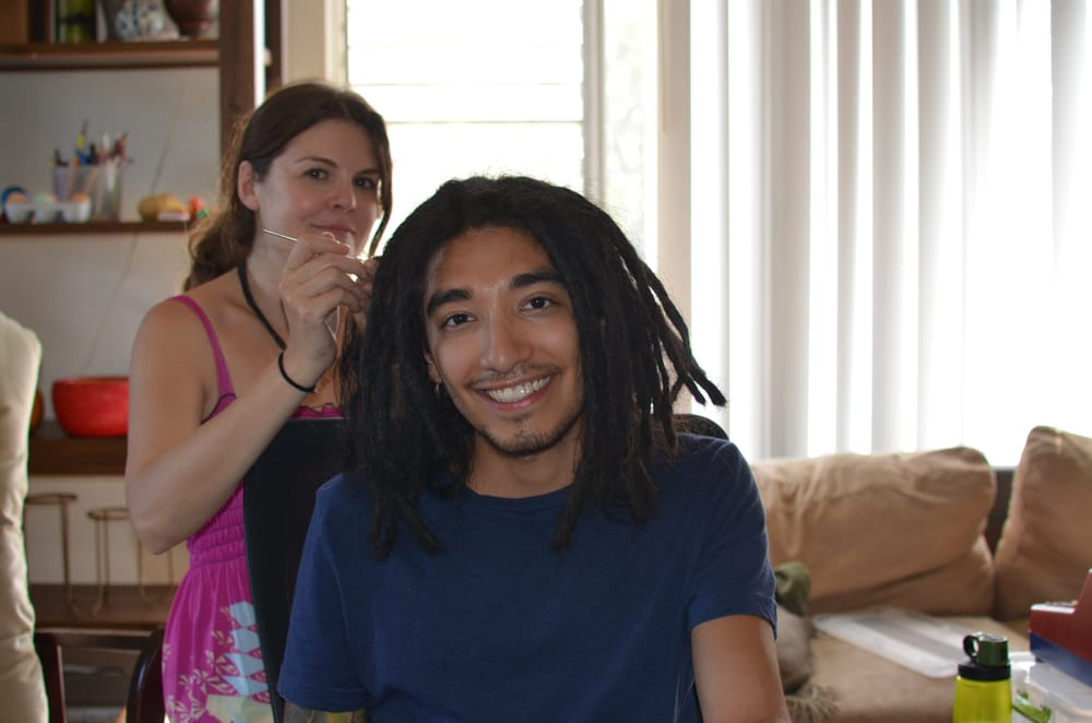 West La Dreads Owner Senior Loctician Hayden Working Some Dread