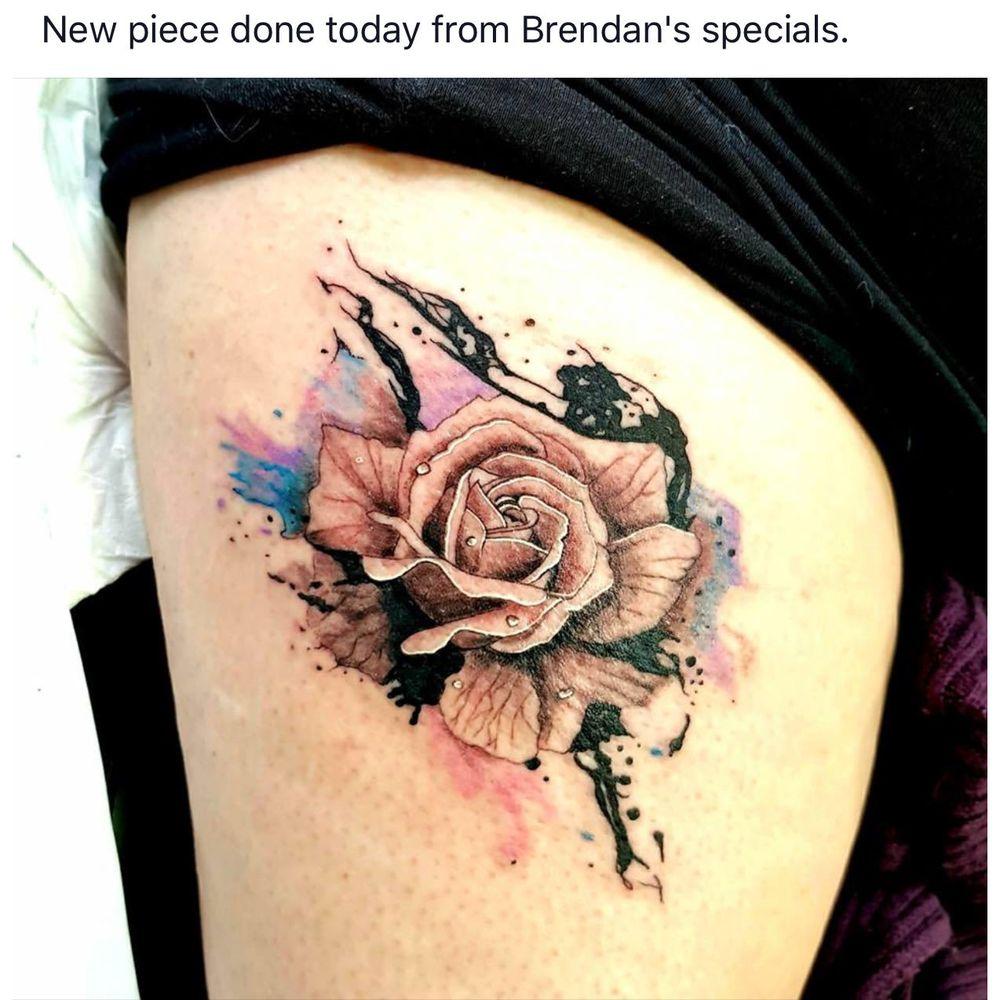 Red dragon tattoo piercing studio tattoo 42 east for Studio 42 tattoo