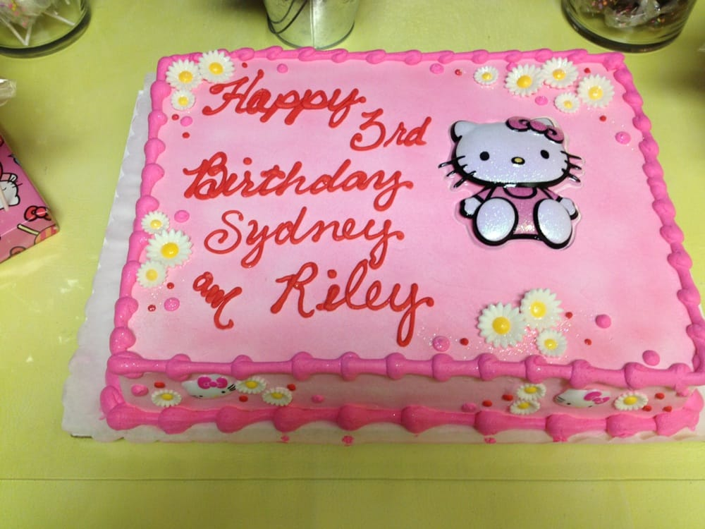 Hello Kitty birthday cake Chocolate cake with whipped icing and