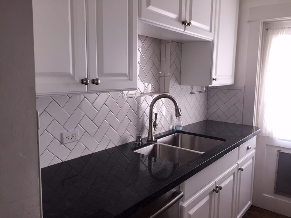 White Subway Laid In A Herringbone Pattern With Sterling