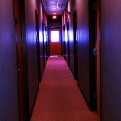 Photo of Zen Massage - Olathe, KS, United States. A long hallway leads