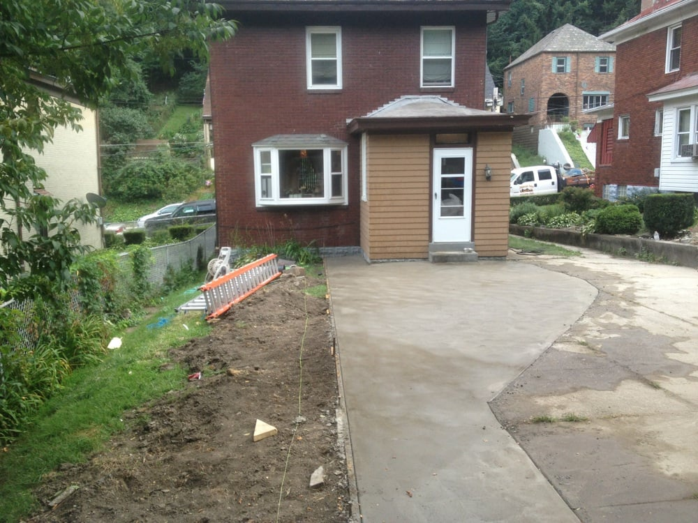 Back Yard Makeover After Concrete Driveway Widening