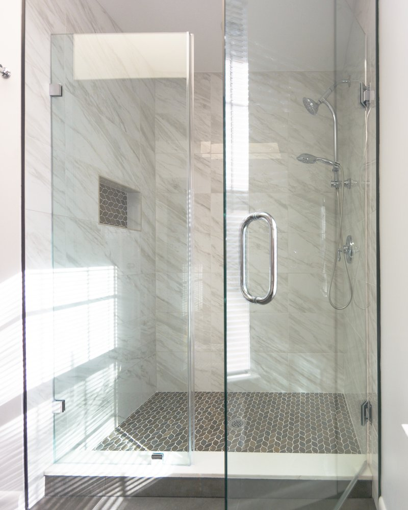 Full Glass Enclosed Shower With Marble Tile On Walls And Matching - Ceramic tile cutting service