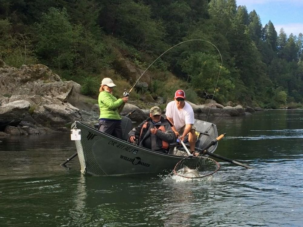 Here 39 s phil netting a king salmon for a lucky angler in for Rogue river fishing