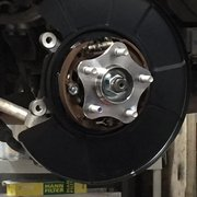 Enthusiast Auto Care - Concord, CA, United States. New proper dust shield installed for brakes. Most mechanics (dealerships) cut the existing dust shield to fit the bigger brakes. Not Eugene!