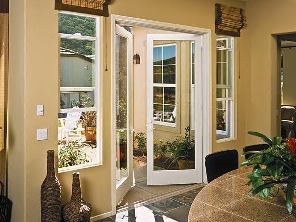 Milgard Single Hung Windows On Each Side Of An Out Swing