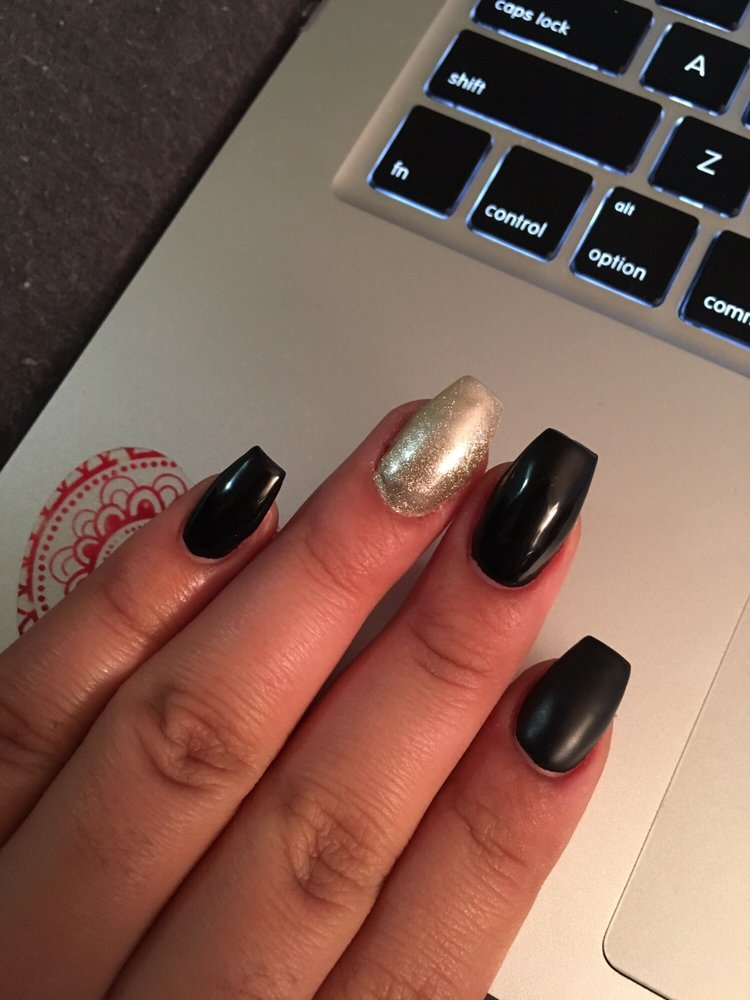 Love my coffin nails by Johnny !! Black gel polish, chrome on ring ...