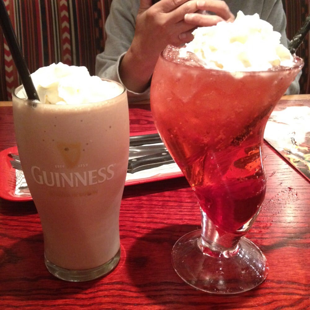 irish beer shake made with guinness stout on the left rasperry
