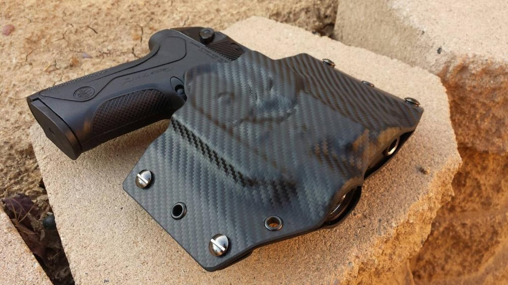 My new custom Kydex holster for a Beretta PX4 Storm with a