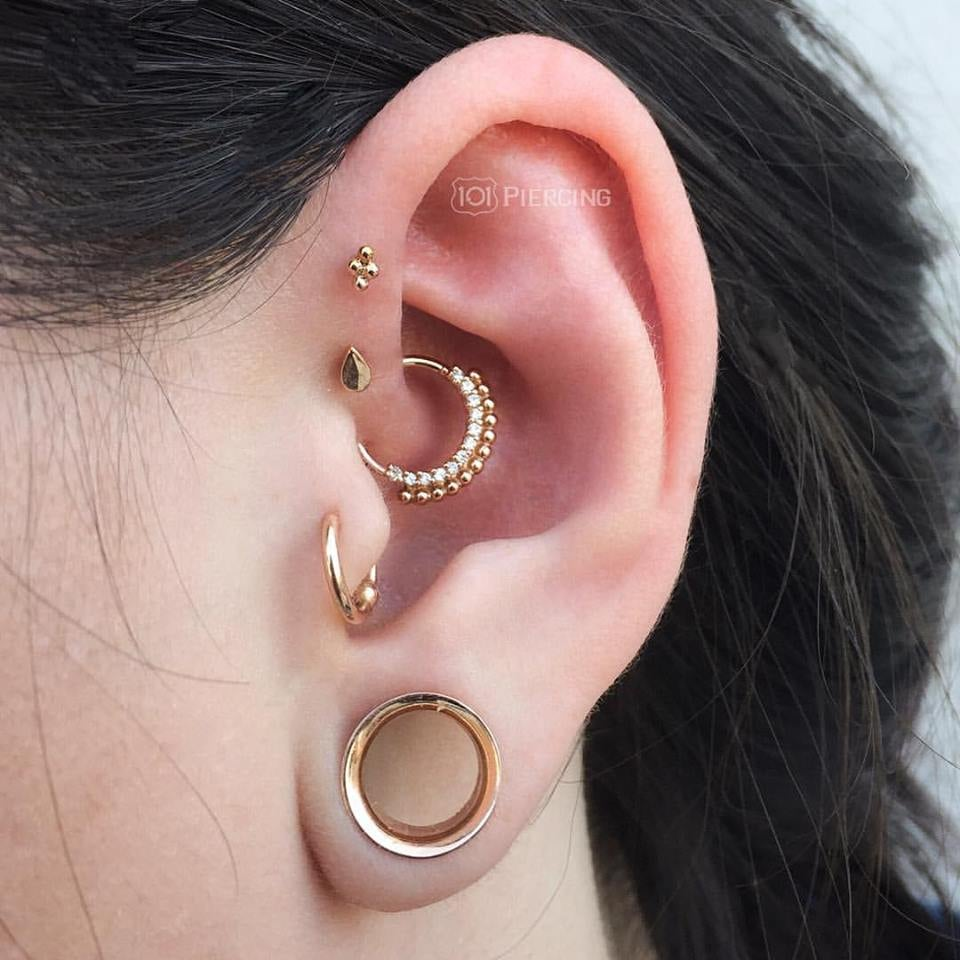 Daith Tragus and Forward Helix Piercings by Bradlee Treutler with