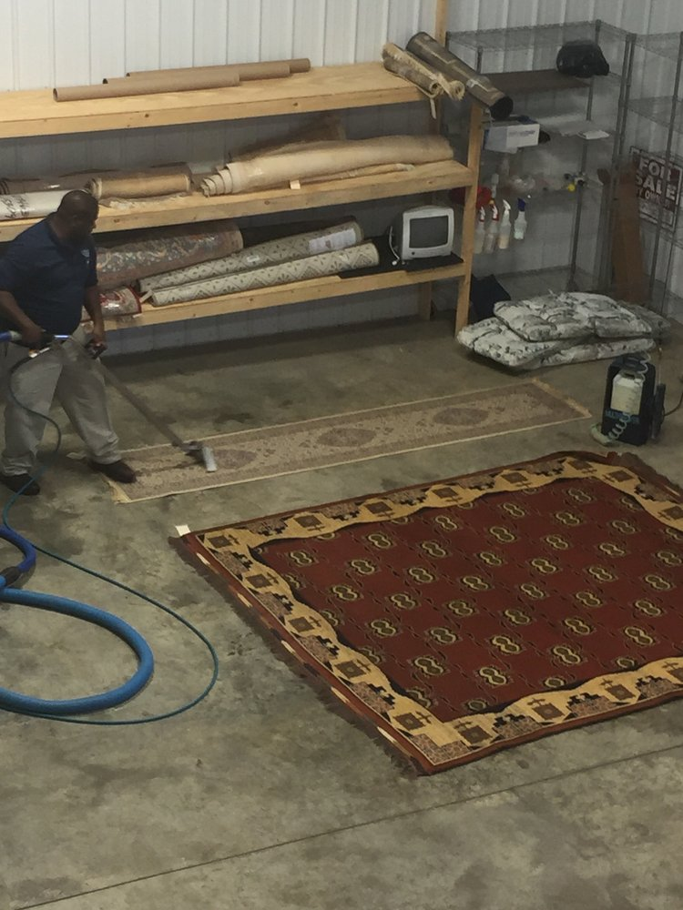 Phil is cleaning some area rugs. This