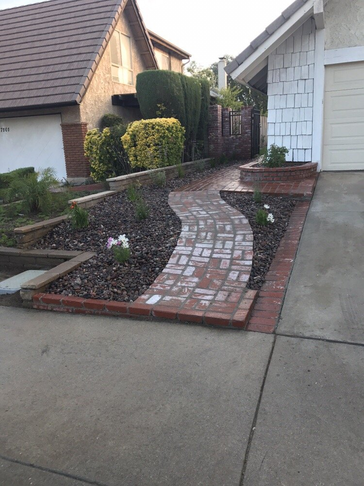 Plants ,drip system, river rock and a brick walk way - Yelp