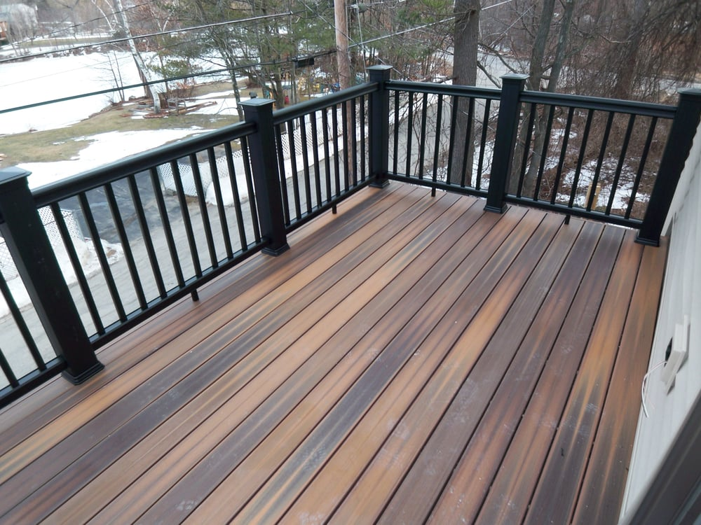 Composite decking and rail system for virtually a for Second floor deck