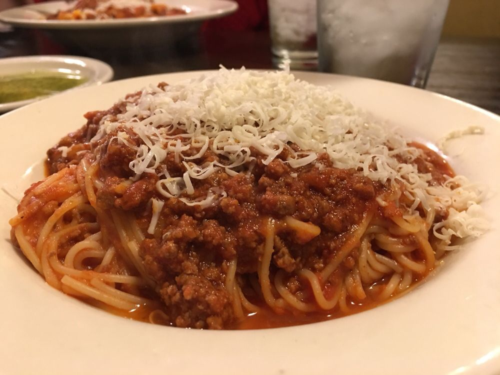 Generous Side Of Angel Hair Pasta With Meat Sauce Topped With Cheese