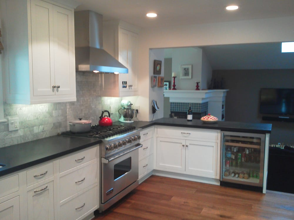 Painted White Shaker Cabinets Wood Floor Black Counter