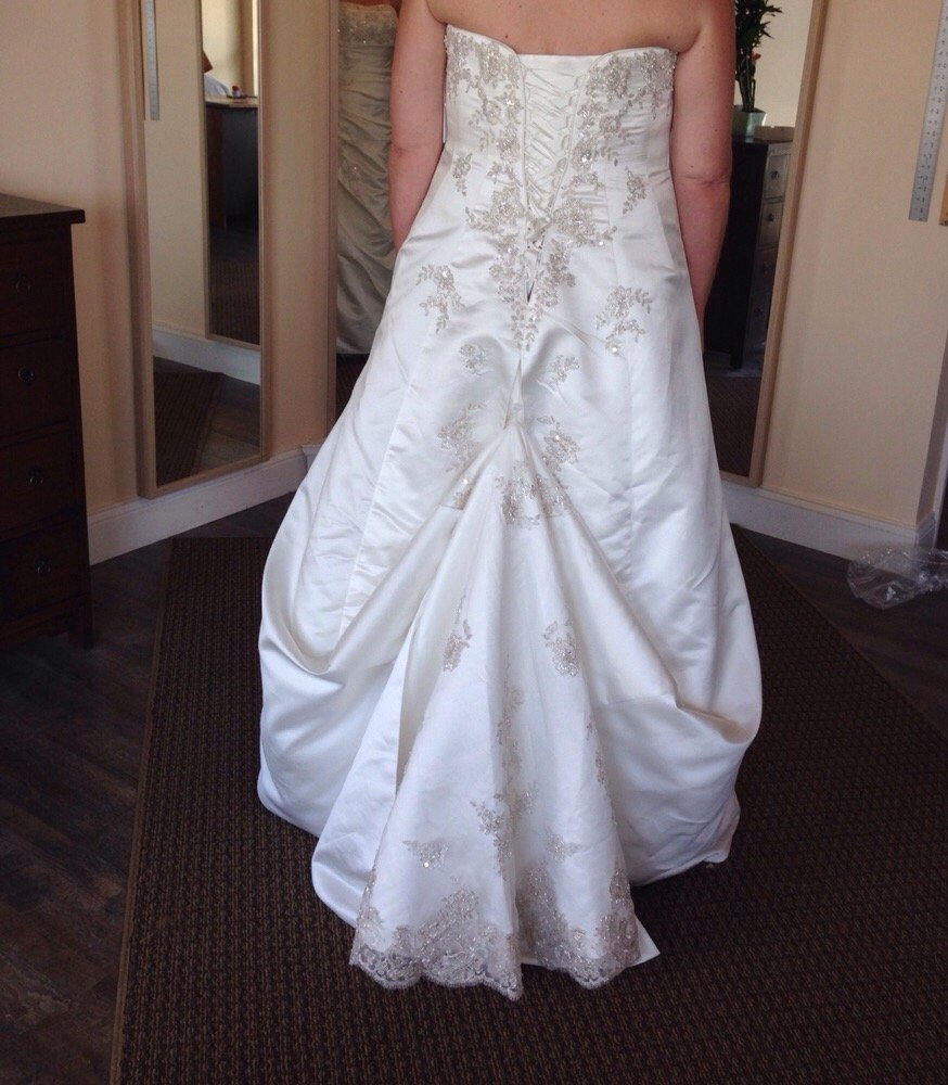 Alteration of wedding gown and creation of bustle yelp for Wedding dress dry cleaning near me