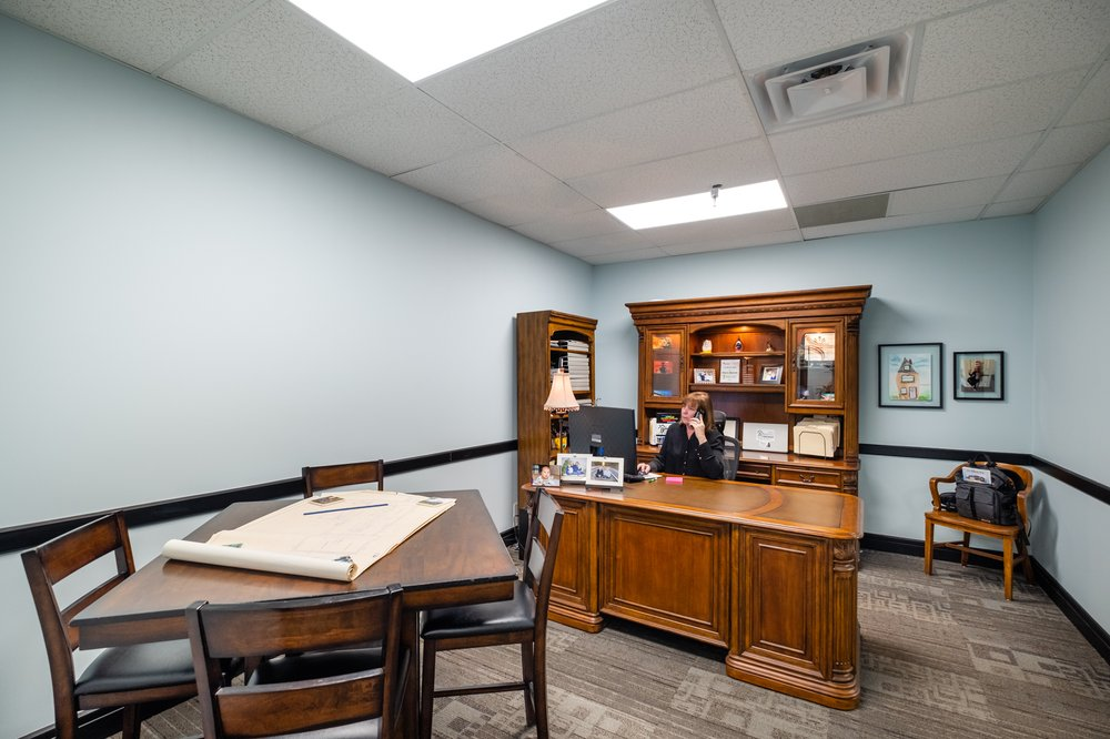 The Sharon Bennett Group - RE/MAX Boone Realty: 33 E Broadway, Columbia, MO