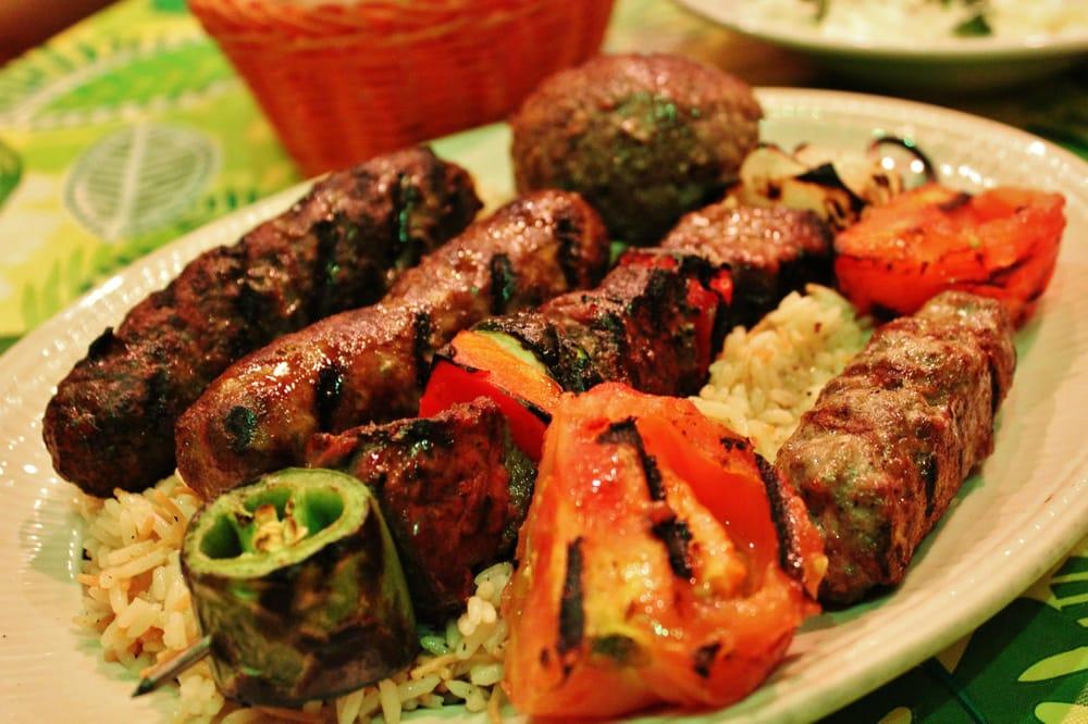 ... Kafta, Mqaniq, Sujuk and kibbi) with rice and grilled tomatoes. The