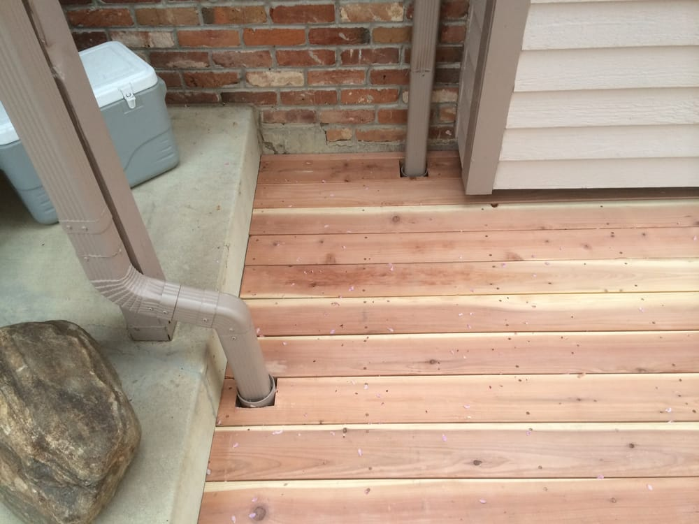 Red Wood Deck With Custom Drainage Added Under Frame For