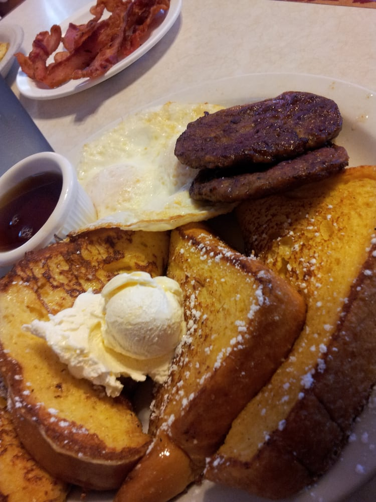French toast combo with sausage patties and eggs over ...