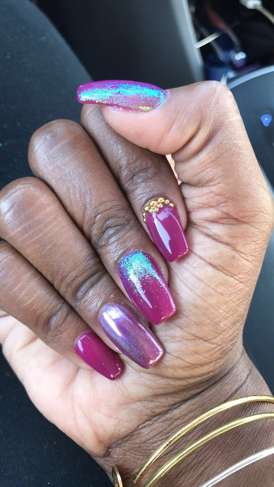 Mood changing gel polish with chrome design, glitter and gold stones ...