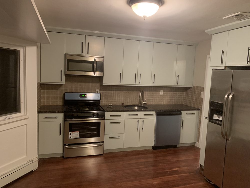 After Refinishing kitchen cabinets and painting in Emerson ...