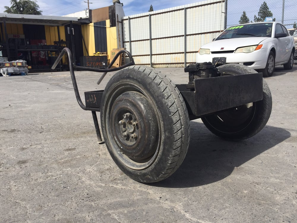 Interesting wheel barrow! My bro said those are spare tires! How ...