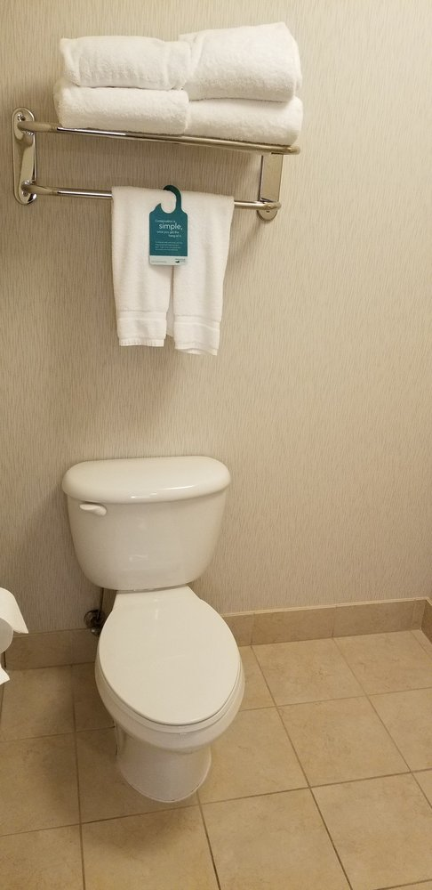 Toilet with plenty of towels for the week. Either I\'m getting taller ...