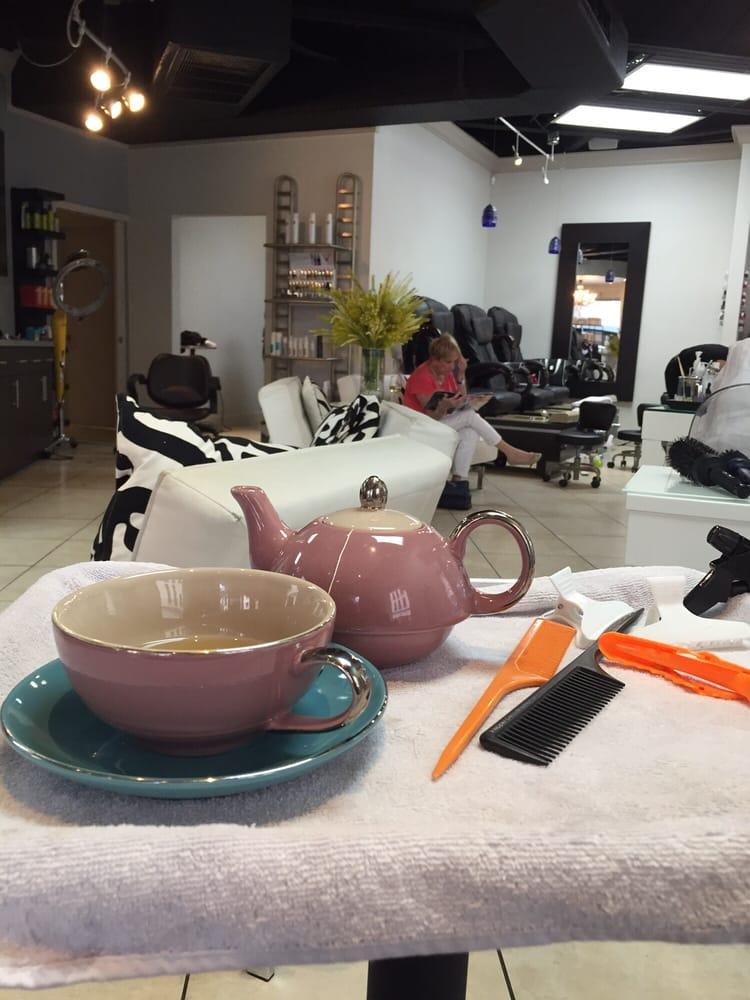Enjoying my tea while the highlights set yelp for Abaka salon coral gables
